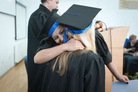 Graduates hugging each other